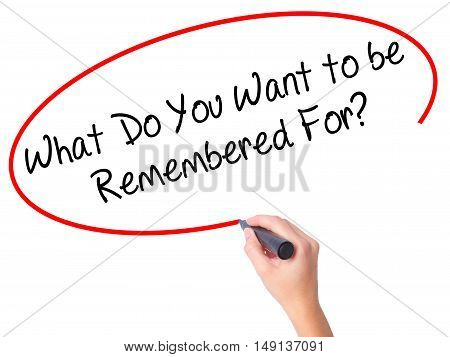 Women Hand Writing What Do You Want To Be Remembered For? With Black Marker On Visual Screen