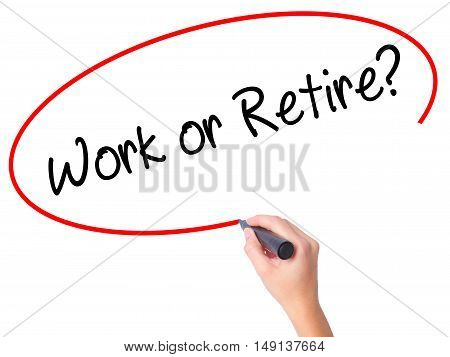 Women Hand Writing Work Or Retire? With Black Marker On Visual Screen