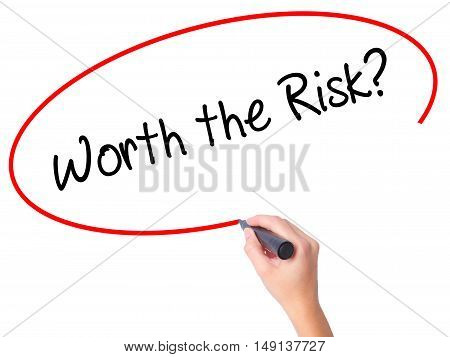 Women Hand Writing Worth The Risk? With Black Marker On Visual Screen