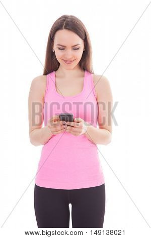 Athletic girl checking her smart phone