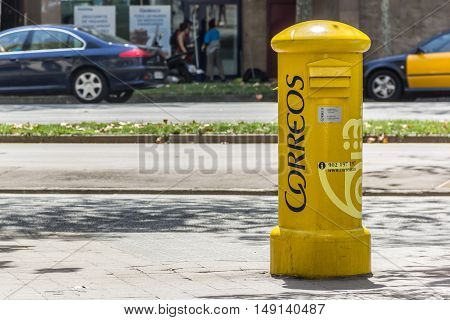 Barcelona Spain - August 17 2016: Yellow mailbox Correos on street. Correos is the national Spanish postal service.