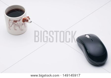 mouse and cup of coffee, mouse black color, mouse on white background, mouse isolated, wireless mouse