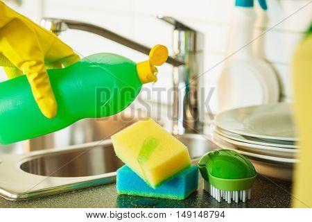 pouring dishwashing liquid on sponge kitchen wash cleaning