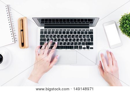 Female Typing On Keypad Topview