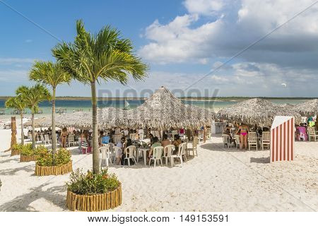 JERICOACOARA, BRAZIL, DECEMBER - 2015 - People at outdoor restaurants at Lagoa do Paraiso beach in Jericoacoara Brazil