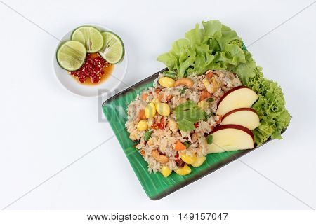 Fried  rice with mixed vegetable as ginko,tofu,corn,lentils,tomato,carrot,taro,mushroom,Lettuce,cashew nut,apple,green lemon and red chili  served with side dish as red chili and green lemon in tofu sauce for Chinese vegetable festival call