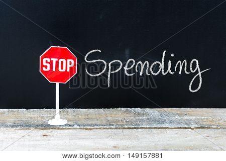 Stop Spending Message Written On Chalkboard