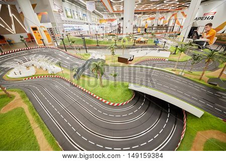 MOSCOW, RUSSIA - APR 02, 2016: Toy racing track in recreational zone Arena of Aviapark shopping center. Aviapark total area of 390 000 sq.m., shopping area - 230 000 sq.m.