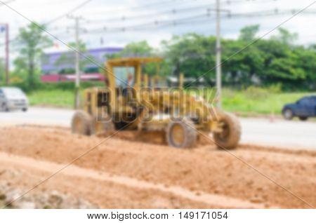 Blurred image motor grader road construction work