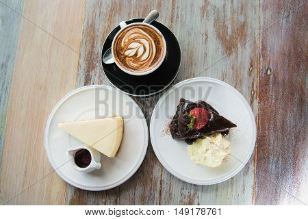 Flourless Chocolate Cake and cheese cake with cappuchino coffee as background