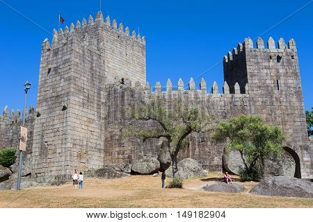 GUIMARAES, PORTUGAL - SEPTEMBER 18, 2016: people at the Castle of Guimaraes. The principal medieval castle in Portugal. Guimaraes, Portugal