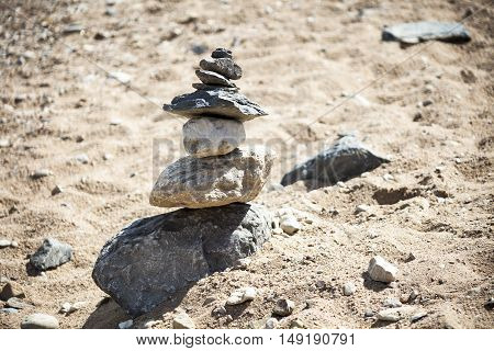 Rocks balanced and stacked on a fresh water beach.