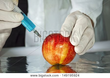 Red apple in genetic engineering laboratory gmo food concept