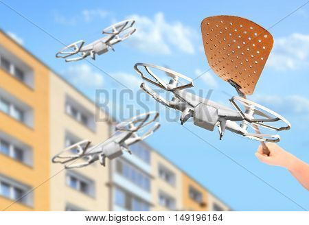 No fly zone. A swatter smashing drones. Rules for UAV traffic. Modern technologies over your head. Digital artwork with fictive copter.