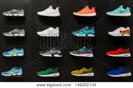 Johannesburg South Africa - September 12 2016: Colorful Nike footwears exhibition on black shelf in store of Johannesburg South Africa. Nike Inc. is an American multinational corporation for the design manufacturing and worldwide marketing of sportwear eq