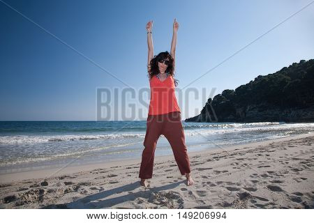 Happy Woman Arms Up In Trebaluger Beach In Minorca