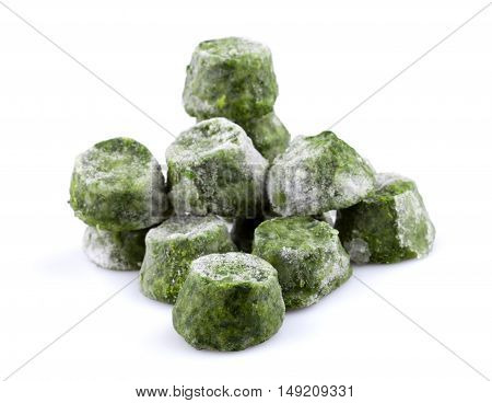 Frozen chopped spinach close-up isolated on white background.