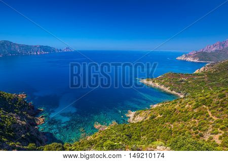 View from famous D81 coastal road with view of Golfe de Girolata from Bocca Di Palmarella Corsica France Europe.