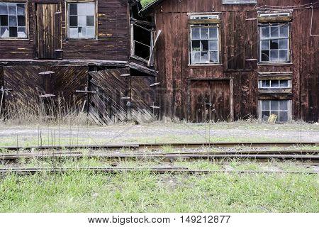 old abandon railroad buildings and railroad tracks