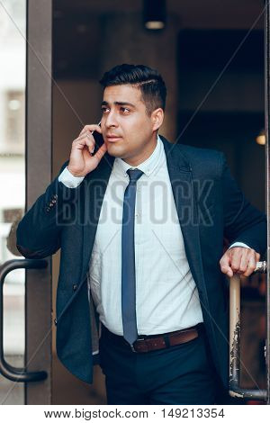 Dynamic successful businessman in a hurry. Being late for meeting. Business and life concept. Making decisions.