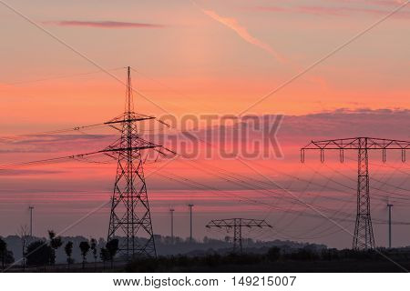 Electricity pylons and lines at dusk, Silhouette electricity pylons