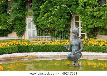 Salzburg Austria - September 3 2016: Fountain with a statue of a woman in Mirabell gardens. It is a very popular touristic place.
