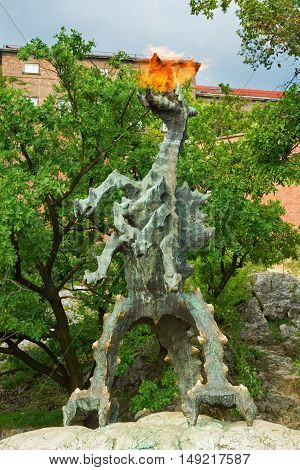 Krakow Poland - 2 September 2016: Statue of a fire breathing dragon near the Wawel castle.