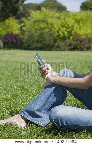 Woman Hand With Phone In Park