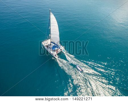 Aerial view of sailing boats walking on the sea in Koh Phangan, Thailand