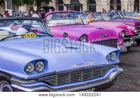 HAVANA CUBA - JULY 18 : Old classic American cars on one of Havana's streets on July 18 2016. There is nearly 60000 vintage American cars in Cuba