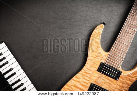 Electric guitar on dark leather background