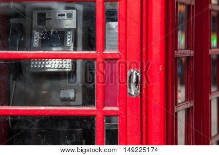 Closeup of red phone box door and window