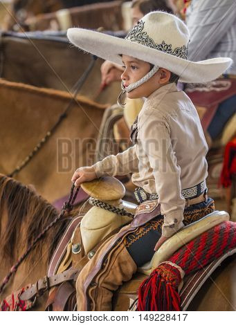 GUADALAJARA MEXICO - SEP 01 : Young charro participates at the 23rd International Mariachi & Charros festival in Guadalajara Mexico on September 01 2016.