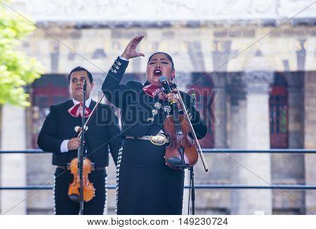GUADALAJARA MEXICO - AUG 28 : Mariachis perform on stage at the 23rd International Mariachi & Charros festival in Guadalajara Mexico on August 28 2016.