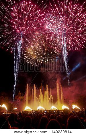 Barcelona, Spain - 25 September 2016: La Merce 2016 fireworks at Magic Fountain.  Crowd attending the 30 minute pyrotechnics finale of La Merce 2016 celebrations at Plaza de Espana.