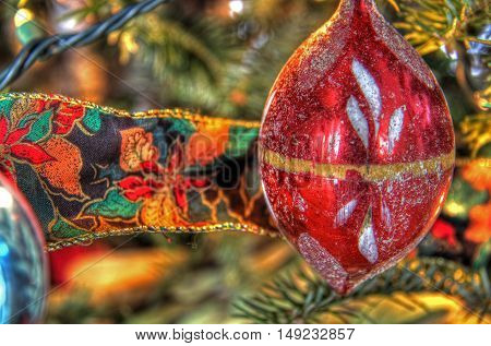 Red Christmas decoration with ribon on a tree