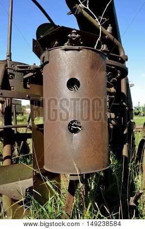 Old seed canister of a corn planter used by birds to create nests.