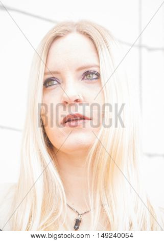 High key portrait of a young Caucasian woman