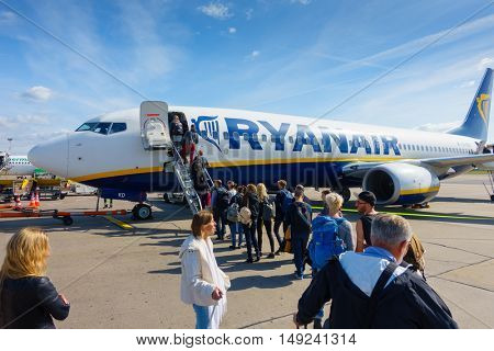 Berlin, Germany - September 20. 2016: Passengers boarding on the aircraft of low cost airline company Ryanair