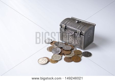 From the trunk sticking ruble next to a pile of coins