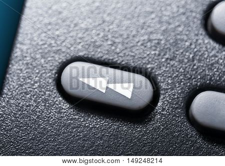 Macro Of A Black Rewind Button On Black Remote Control For A Hifi Stereo Audio System
