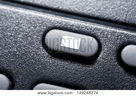 Macro Of A Black Stop Button On Black Remote Control For A Hifi Stereo Audio System