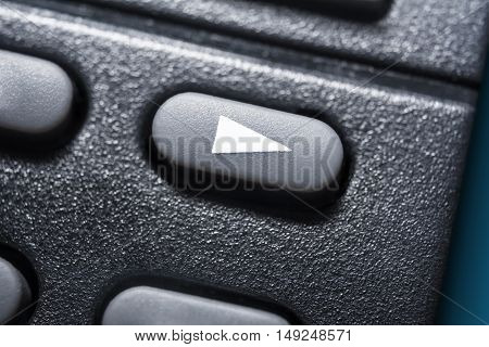 Macro Of A Black Play Button On Black Remote Control For A Hifi Stereo Audio System