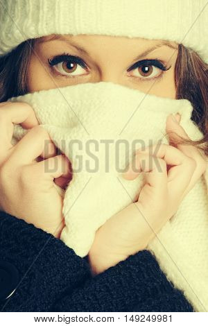 Winter woman covering mouth with scarf