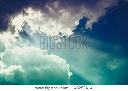 Attractive photo of beautiful blue sky with cloudy and sunbeam. Outdoor at the daytime. Natural sky composition. Beautiful nature use as background. Cross process and vintage tone effect.