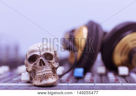Human Skull Resting On A Sound Mixer
