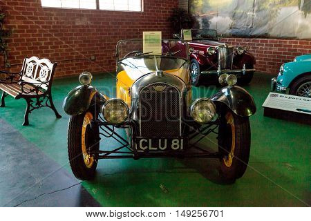 El Segundo, CA, USA - September 26, 2016: Bright yellow 1935 Morgan displayed at the Automobile Driving Museum in El Segundo, California, United States. Editorial use only.
