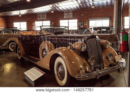 El Segundo, CA, USA - September 26, 2016: Tan and maroon 1937 Packard V12 displayed at the Automobile Driving Museum in El Segundo, California, United States. Editorial use only.