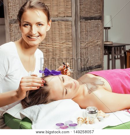 stock photo attractive lady getting spa treatment in salon, lifestyle people concept