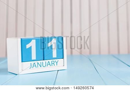 January 11th. Day 11 of month, calendar on wooden background. Winter concept. Empty space for text.